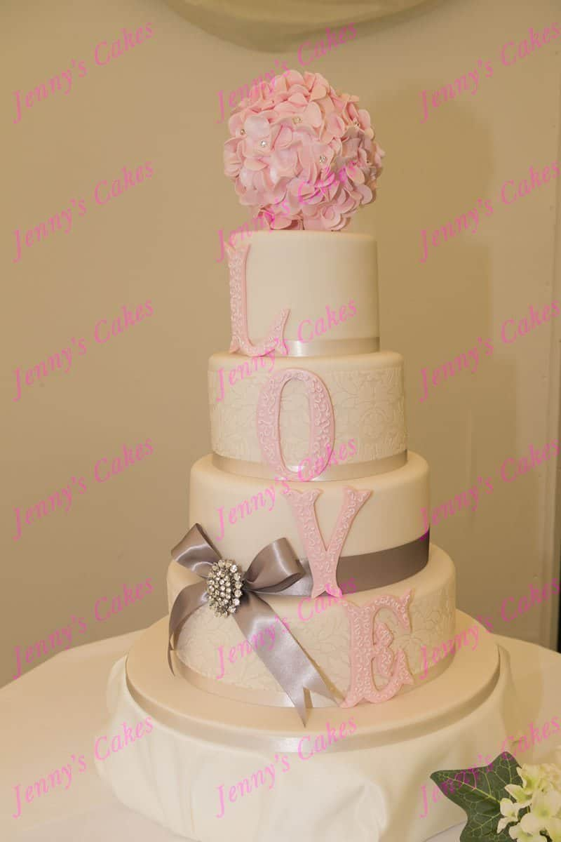Designer Wedding Cake with LOVE Letters and Ruffle Ball Cake Topper