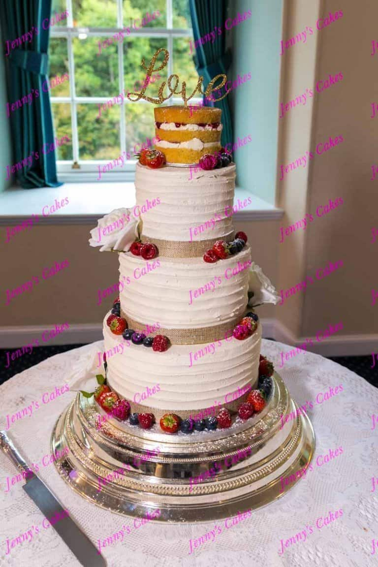 naked wedding cake top tier with butter-cream finish