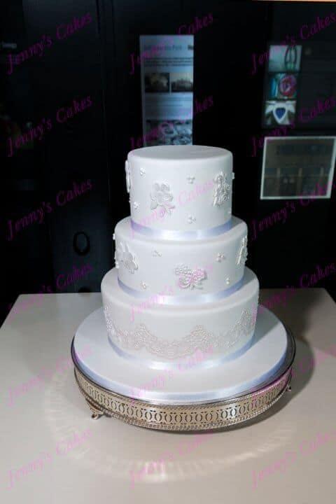 3 Tier wedding cake with sugar lace pieces