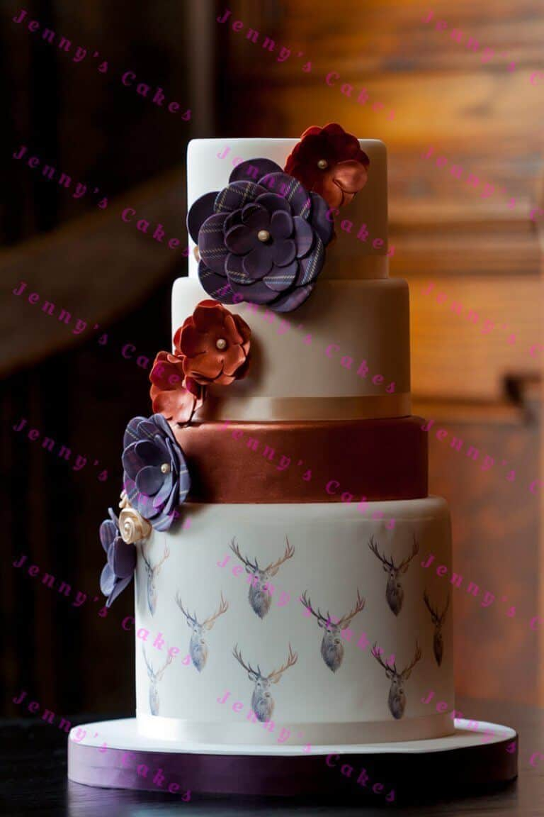 Designer Scottish Wedding cake, with Stags and Tartan flowers