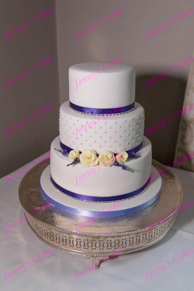 3 Tier Wedding cake with Dots and sugar Rosebuds