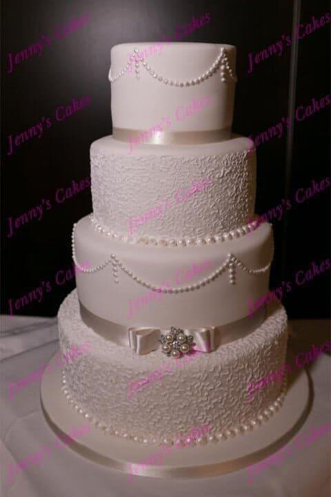 Elegant Textured Wedding Cake with Dior Bow