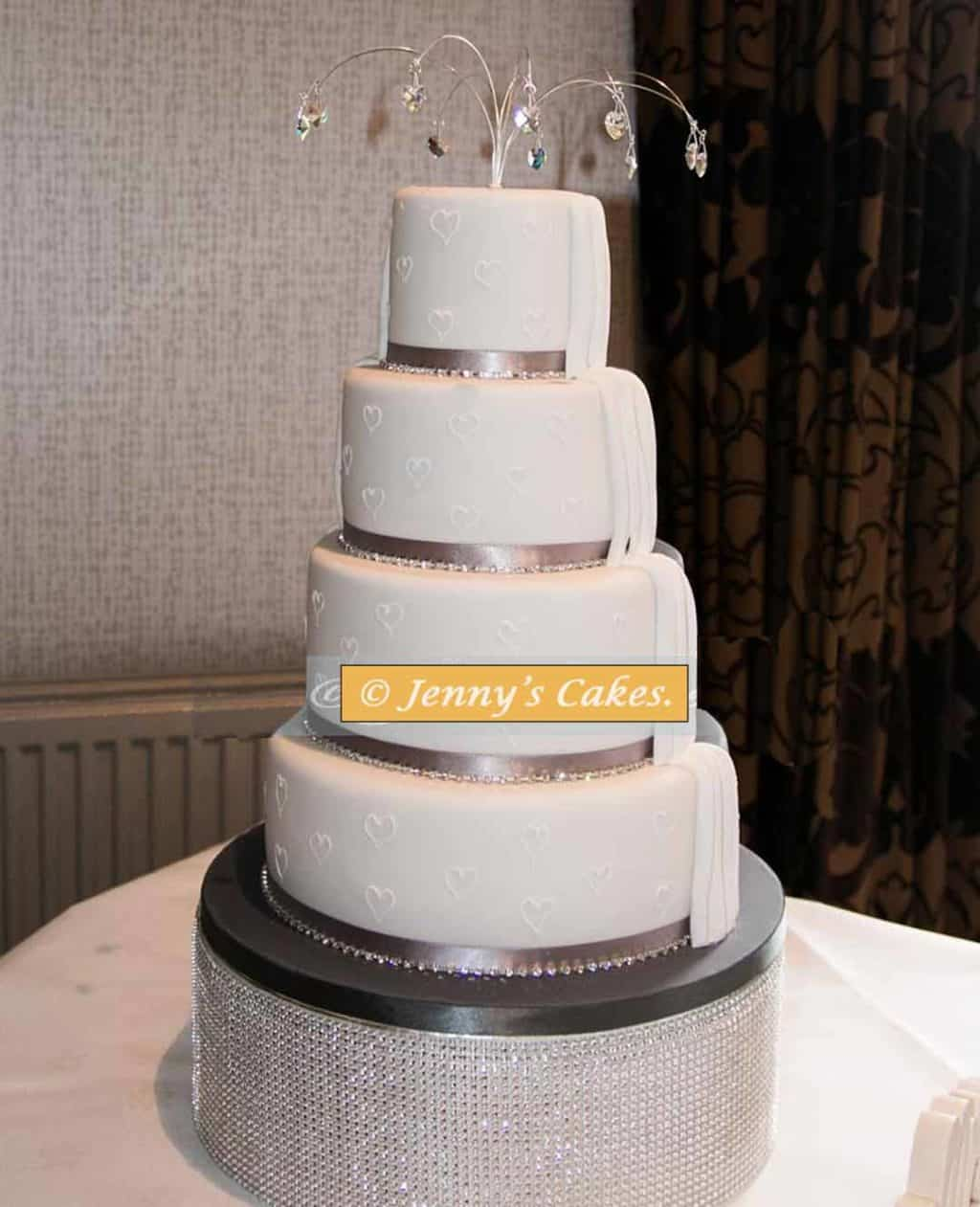 five tier wedding cake with crystal topper and front