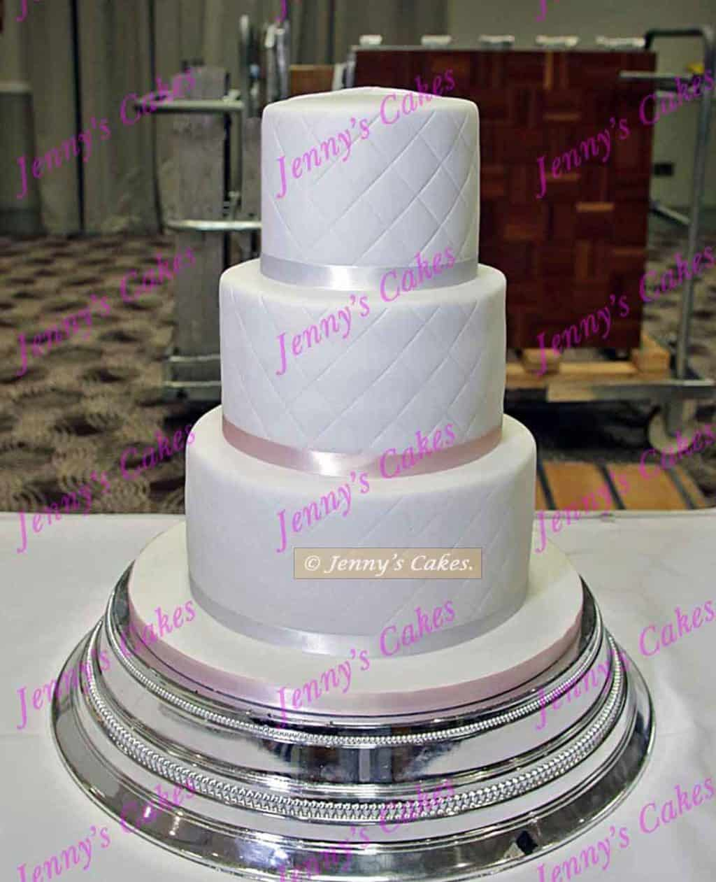 conventional wedding cake with star wards details at the back