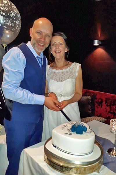 Cutting the Wedding Cake Photo- Karen and John in Gretna Green.